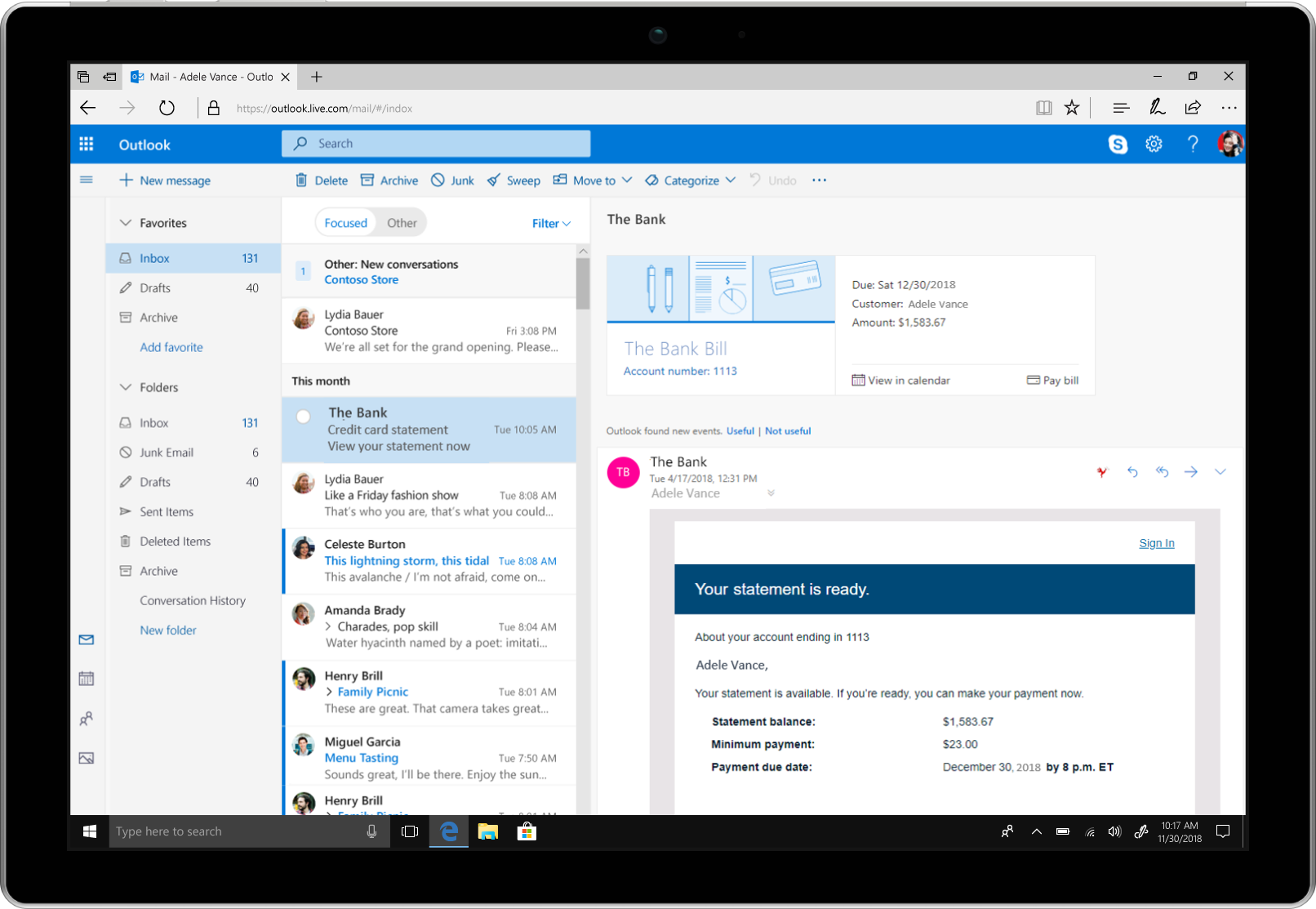 A tablet showcases bill pay reminders in Outlook.